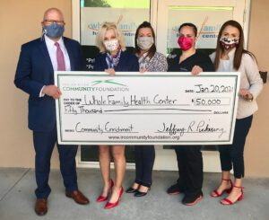 Whole Family Health Center. Photo ID: Jeff Pickering, CEO of Indian River Community Foundation, with Marie Andress, Carly Pye, Christina Martinez, and Sophia North of Whole Family Health Center.